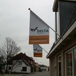 Vlag met reclame - Delta Makelaars