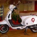 Vervoersreclame scooter - Q Makelaars